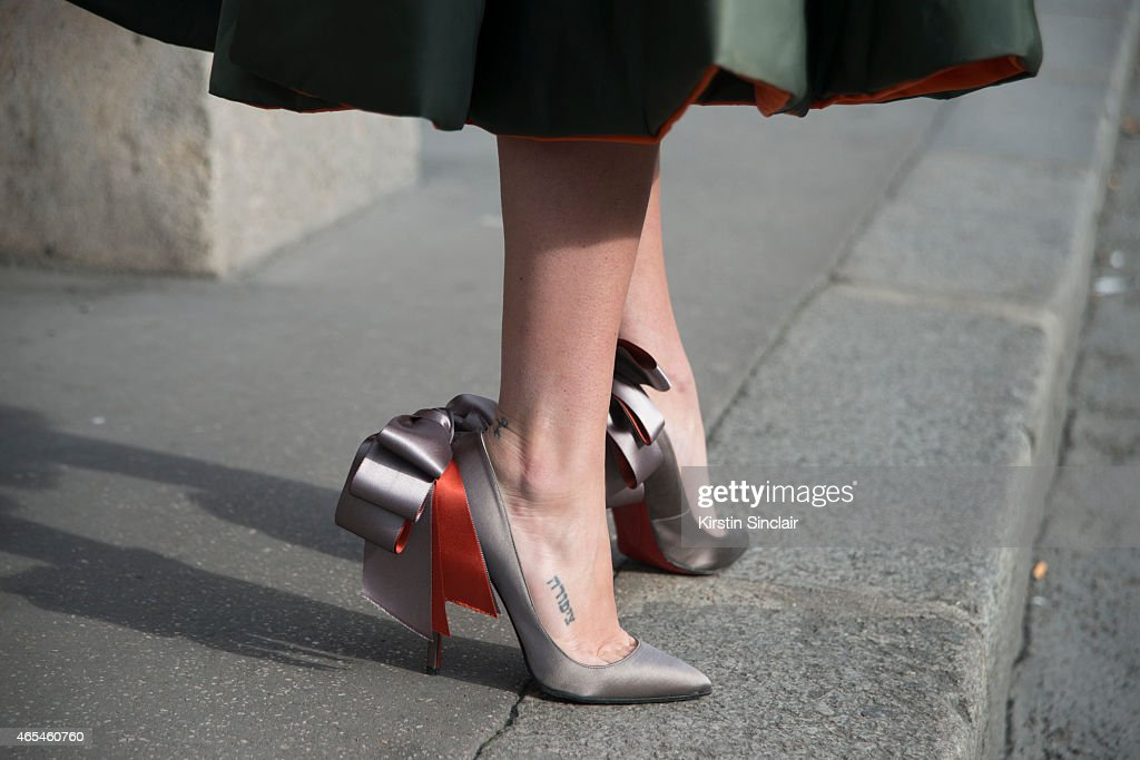 Writer Natasha Goldenberg wears Dior coat and Christian Louboutin shoes on day 4 of Paris Collections Women on March 06 2015 in Paris France