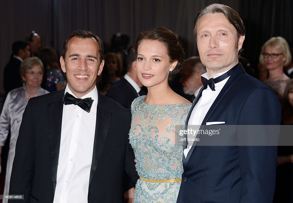 Writer Nikolaj Arcel, actors Alicia Vikander and Mads Mikkelsen arrives at the Oscars at Hollywood & Highland Center on February 24, 2013 in Hollywood, California.