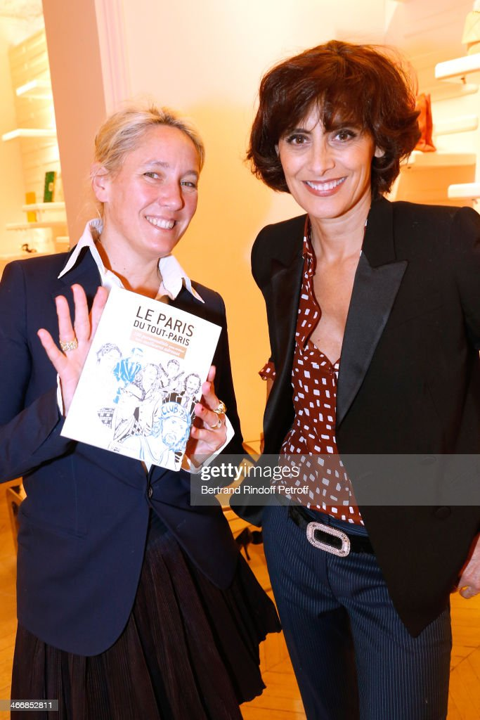 Writer of the book Alexandra Senes and Fashion Designer <a gi-track='captionPersonalityLinkClicked' href=/galleries/search?phrase=Ines+de+la+Fressange&family=editorial&specificpeople=2078500 ng-click='$event.stopPropagation()'>Ines de la Fressange</a> attends the 'Le Paris du Tout Paris' : Book Presentation at Maison Roger Vivier on February 4, 2014 in Paris, France.
