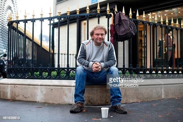 Writer of the book 'Je tape la manche' JeanMarie Roughol poses on October 6 2015 in Paris After more than 20 years living of begging in the street...