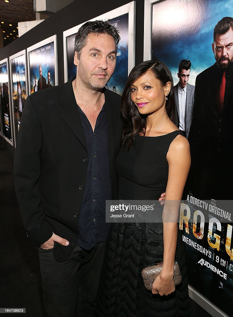 Writer OI Parker and actress <a gi-track='captionPersonalityLinkClicked' href=/galleries/search?phrase=Thandie+Newton&family=editorial&specificpeople=210812 ng-click='$event.stopPropagation()'>Thandie Newton</a> attend the Los Angeles Premiere of 'Rogue' at ArcLight Cinemas on March 26, 2013 in Hollywood, California.