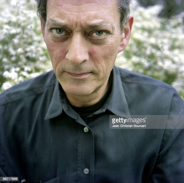 Writer Paul Auster poses for a portrait in his home garden on October 5 2005 in New York City