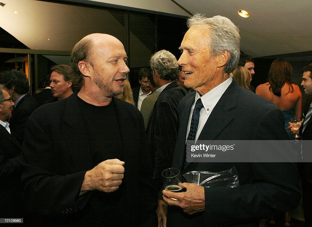 Writer Paul Haggis (L) and actor/director Clint Eastwood talk at the afterparty for the premiere of Paramount's 'Flags Of Our Fathers' at the Academy of Motion Picture Arts and Sciences on October 9, 2006 in Beverly Hills, California.