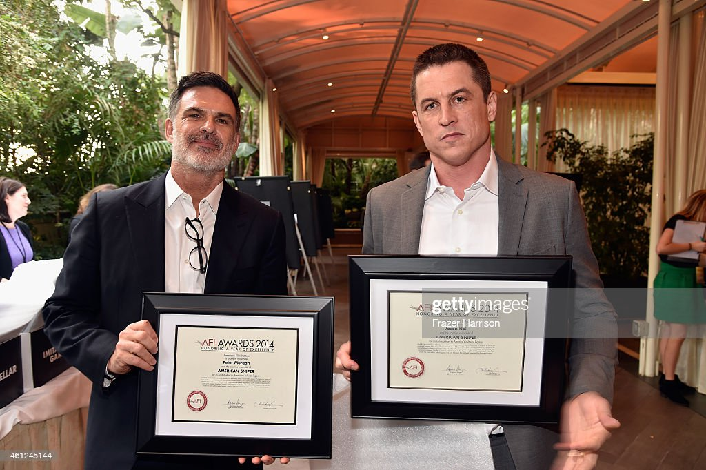 Writer Peter Morgan (L) and actor Jason Hall pose with awards during the 15th Annual AFI Awards at Four Seasons Hotel Los Angeles at Beverly Hills on January 9, 2015 in Beverly Hills, California.