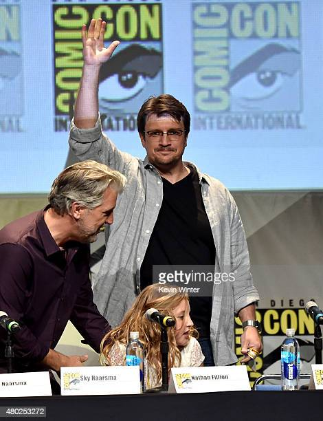 Writer PJ Haarsma actors Nathan Fillion and Sky Haarsma speak onstage during 'Con Man' The Fan Revolt 13 Years In The Making panel during ComicCon...