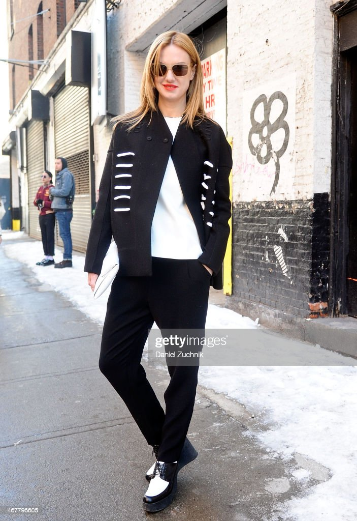 Writer Polina Proshkina is seen outside the Cushnie et Ochs show wearing a Rick Owens jacket, Celine shoes and a Jil Sander bag on February 7, 2014 in New York City.
