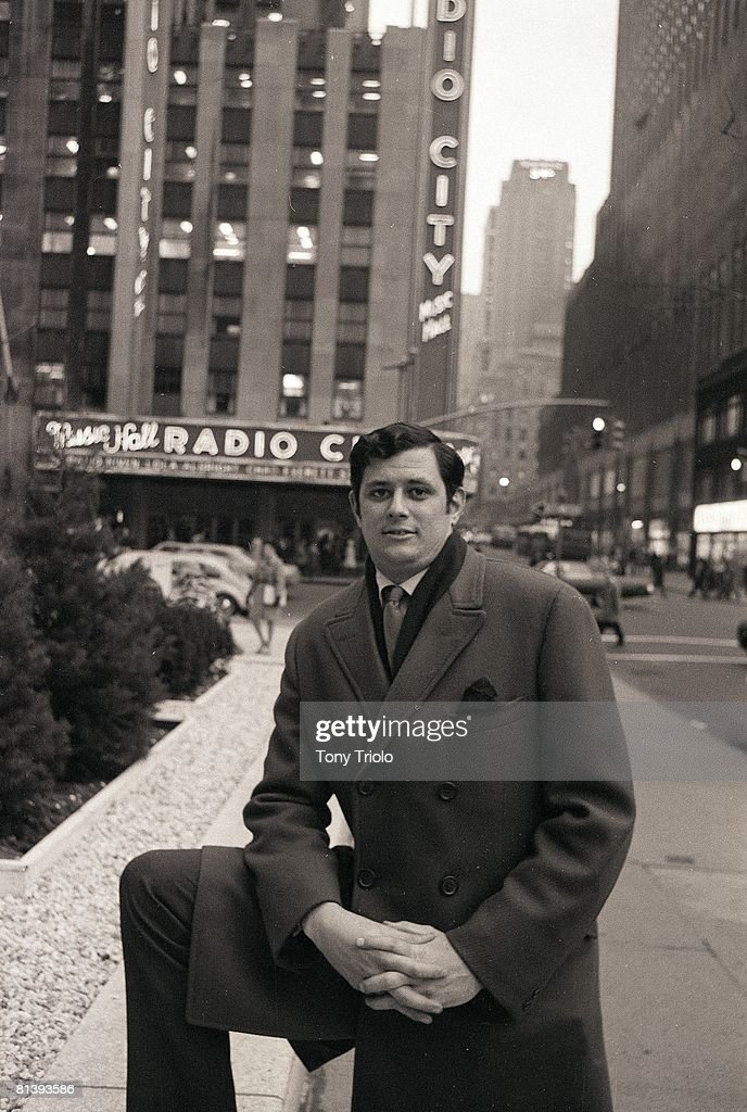 Portrait of Frank Deford outside Time & Life Building, View of Radio City Music Hall, New York, NY 1/6/1969