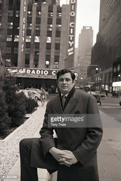 Portrait of Frank Deford outside Time Life Building View of Radio City Music Hall New York NY 1/6/1969