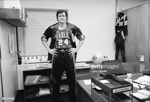 Portrait of Frank Deford wearing Harlem Globetrotters uniform in office at Time Life Building Deford played with the New York Nationals during their...