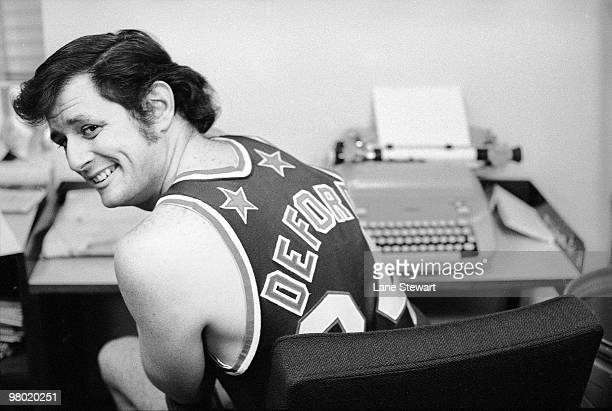 Pub Memo Portrait of Frank Deford wearing Harlem Globetrotters uniform in office at Time Life Building Deford played with the New York Nationals...