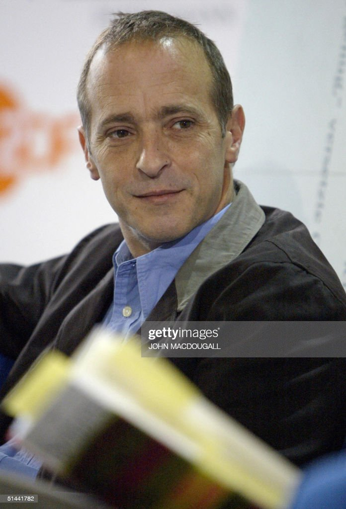 US writer residing in France <a gi-track='captionPersonalityLinkClicked' href=/galleries/search?phrase=David+Sedaris&family=editorial&specificpeople=1056693 ng-click='$event.stopPropagation()'>David Sedaris</a> is interviewed by German TV channel ZDF during the Frankfurt Book Fair 08 October 2004. AFP PHOTO JOHN MACDOUGALL