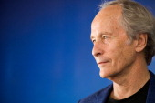 Writer Richard Ford poses at a photocall after receiving the 2013 Lucien Barriere literature prize for his book 'Canada' during the 39th Deauville...
