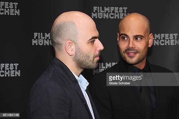 Writer Roberto Saviano and actor Marco D'Amore attend the 'Gomorrah' Premiere as part of Filmfest Muenchen 2014 at on June 29 2014 in Munich Germany