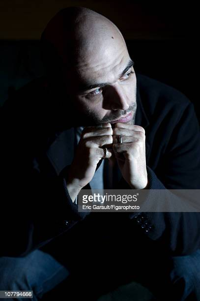 Writer Roberto Saviano poses at a photo shoot for Le Figaro on May 2 2009 in Paris France Figaro ID 084422014 CREDIT MUST READ Eric...