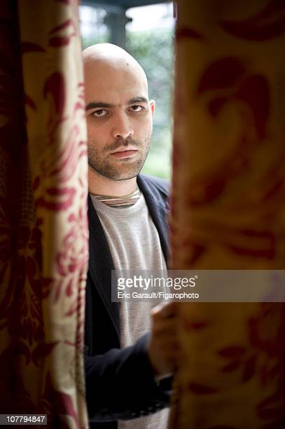 Writer Roberto Saviano poses at a photo shoot for Le Figaro on May 2 2009 in Paris France Figaro ID 084422013 CREDIT MUST READ Eric...