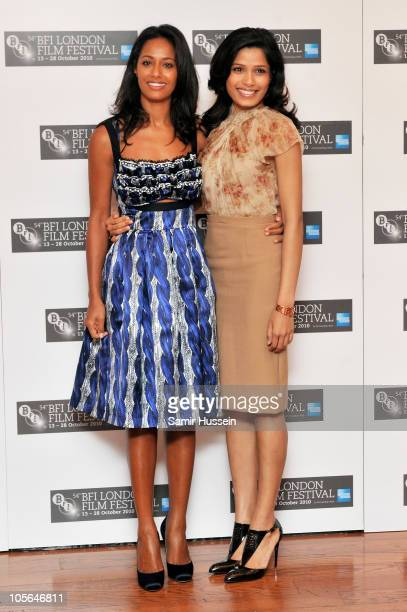 Writer Rula Jebreal and actress Freida Pinto attend the 'Miral' photocall during the 54th BFI London Film Festival at the Vue West End on October 18...