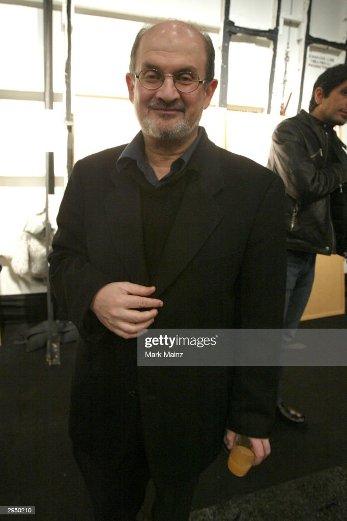 Writer Salman Rushdie appears backstage at the Luca Luca Fall 2004 fashion show during the Olympus Fashion Week Fall 2004 at Bryant Park February 8, 2004 in New York City.