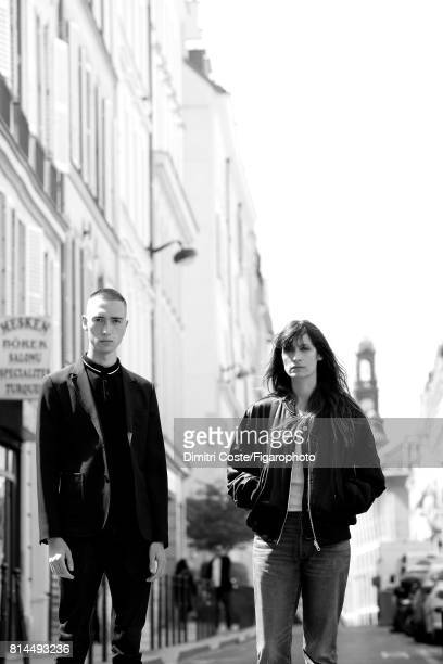 Writer Simon Johannin and model Caroline de Maigret are photographed for Madame Figaro on May 10 2017 in Paris France Johannin Jacket polo jeans...