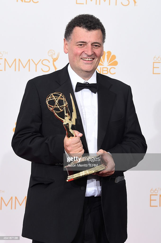 Writer Steven Moffat , winner of the Outstanding Writing for a Miniseries, Movie or a Dramatic Special Award for Sherlock: 'His Last Vow', poses in the press room during the 66th Annual Primetime Emmy Awards held at Nokia Theatre L.A. Live on August 25, 2014 in Los Angeles, California.
