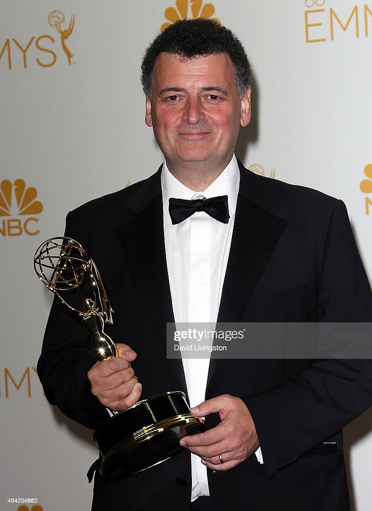 Writer Steven Moffat, winner of the Outstanding Writing for a Miniseries, Movie or a Dramatic Special Award for Sherlock: 'His Last Vow', poses in the press room at the 66th Annual Primetime Emmy Awards at the Nokia Theatre L.A. Live on August 25, 2014 in Los Angeles, California.