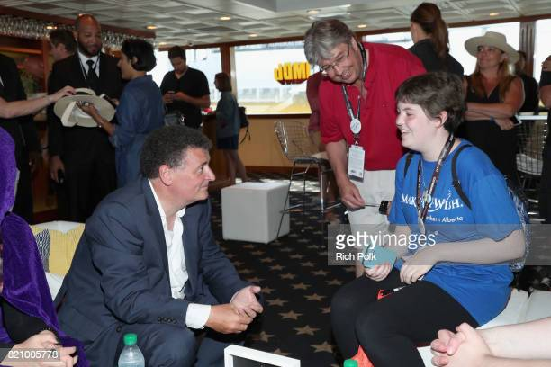 Writer Steven Moffat with MakeAWish kids on the #IMDboat at San Diego ComicCon 2017 at The IMDb Yacht on July 22 2017 in San Diego California