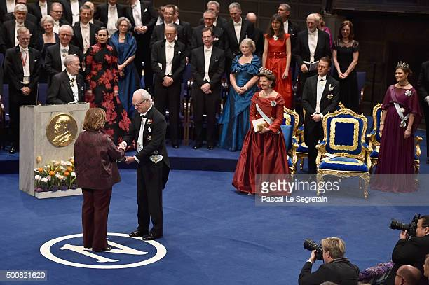 Writer Svetlana Alexievich laureate of the Nobel Prize in Literature receives her Nobel Prize from King Carl XVI Gustaf of Sweden during the Nobel...