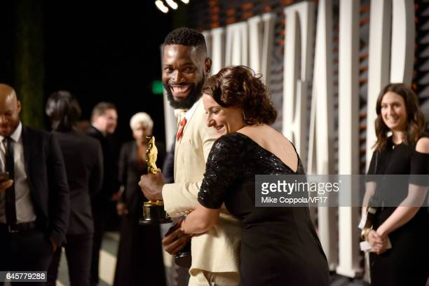 Writer Tarell Alvin McCraney and producer Adele Romanski attend the 2017 Vanity Fair Oscar Party hosted by Graydon Carter at Wallis Annenberg Center...