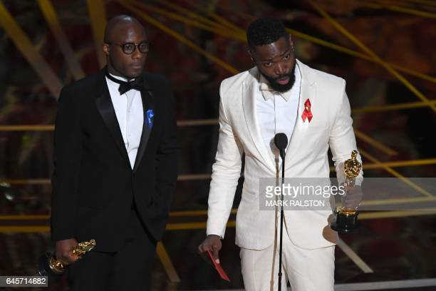 TOPSHOT US writer Tarell Alvin McCraney delivers a speech on stage next to US director Barry Jenkins after they won the Best Adapted Screenplay for...