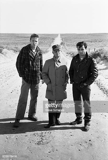 Writer Truman Capote and actors Robert Blake and Scott Wilson pose for a photo on location for the film In Cold Blood based on Capote's novel