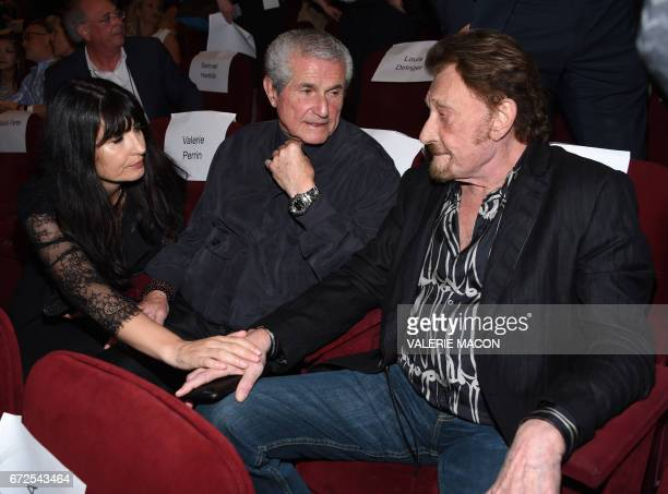 Writer Valerie Perrin director Claude Lelouch and singer Johnny Hallyday attend the Colcoa French Film Festival Opening night on April 24 2017 in Los...