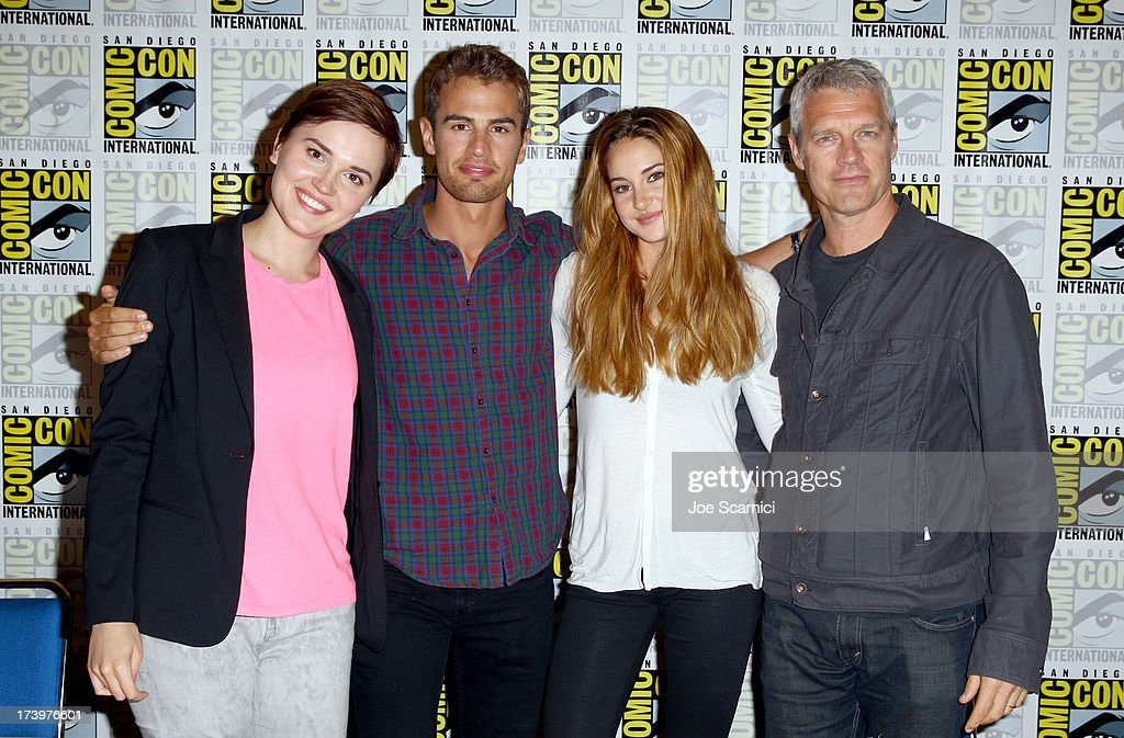 Writer Veronica Roth, actor <a gi-track='captionPersonalityLinkClicked' href=/galleries/search?phrase=Theo+James&family=editorial&specificpeople=7989783 ng-click='$event.stopPropagation()'>Theo James</a>, actress <a gi-track='captionPersonalityLinkClicked' href=/galleries/search?phrase=Shailene+Woodley&family=editorial&specificpeople=676833 ng-click='$event.stopPropagation()'>Shailene Woodley</a>, and director <a gi-track='captionPersonalityLinkClicked' href=/galleries/search?phrase=Neil+Burger&family=editorial&specificpeople=2079856 ng-click='$event.stopPropagation()'>Neil Burger</a> attend the 'Ender's Game' and 'Divergent' cast autograph signing during Comic-Con International 2013 at San Diego Convention Center on July 18, 2013 in San Diego, California.