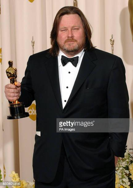 OVER Writer William Monahan receives the Award for Best Adapted Screenplay for 'The Departed' during the 79th Academy Awards at the Kodak Theatre Los...
