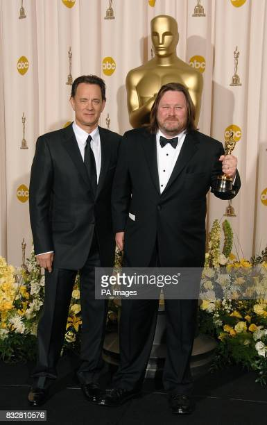 Writer William Monahan with the award for Best Adapted Screenplay for 'The Departed' with Tom Hanks at the 79th Academy Awards Los Angeles