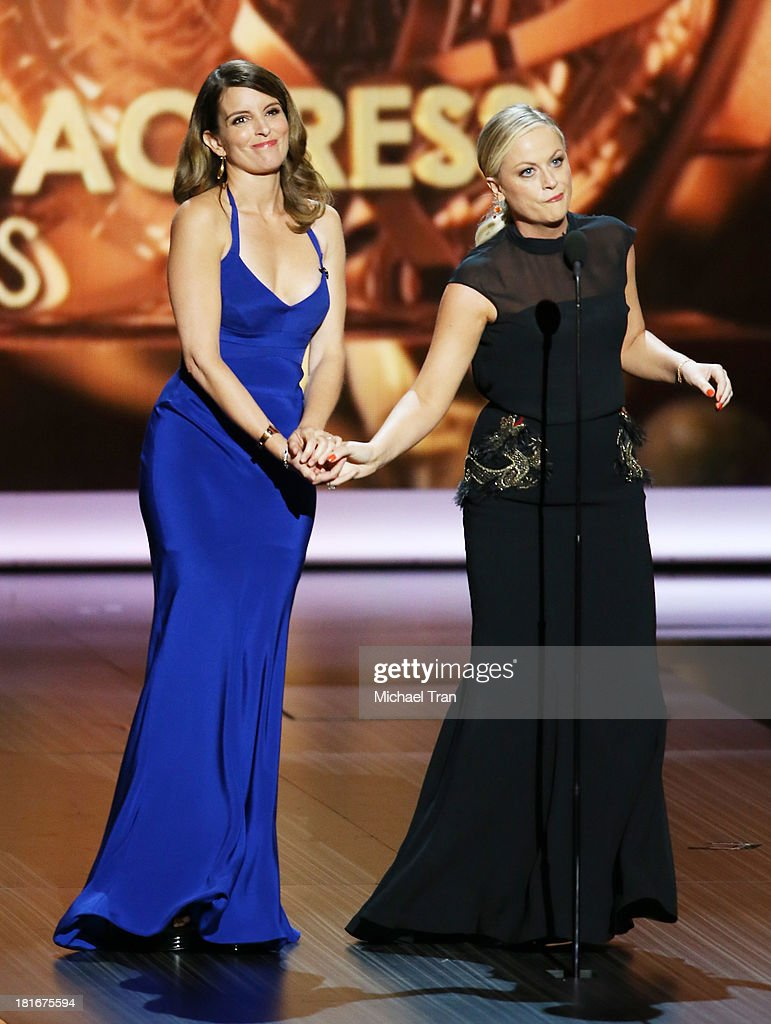 Writer/actresses <a gi-track='captionPersonalityLinkClicked' href=/galleries/search?phrase=Tina+Fey&family=editorial&specificpeople=206753 ng-click='$event.stopPropagation()'>Tina Fey</a> and <a gi-track='captionPersonalityLinkClicked' href=/galleries/search?phrase=Amy+Poehler&family=editorial&specificpeople=228430 ng-click='$event.stopPropagation()'>Amy Poehler</a> speak onstage during the 65th Annual Primetime Emmy Awards held at Nokia Theatre L.A. Live on September 22, 2013 in Los Angeles, California.