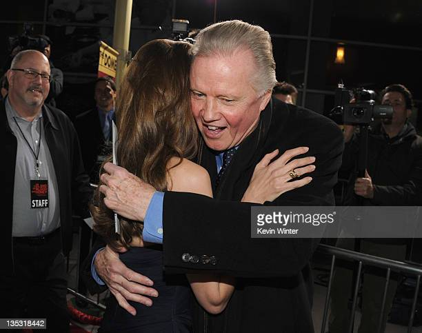 Writer/director Angelina Jolie and actorJon Voight arrive at the premiere of FilmDistrict's 'In the Land of Blood and Honey' held at ArcLight Cinemas...