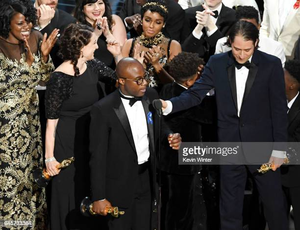 Writer/director Barry Jenkins and producer Jeremy Kleiner accept Best Picture for 'Moonlight' onstage during the 89th Annual Academy Awards at...
