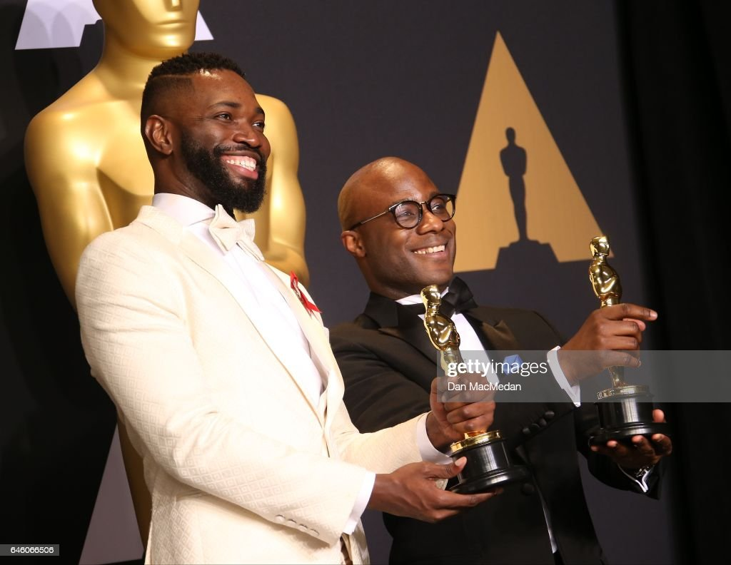 Writer/director Barry Jenkins (R) and writer Tarell Alvin McCraney pose in the press room with the Best Adapted Screenplay award for 'Moonlight' at the 89th Annual Academy Awards at Hollywood & Highland Center on February 26, 2017 in Hollywood, California.