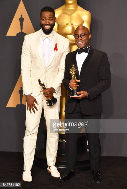 Writer/director Barry Jenkins and writer Tarell Alvin McCraney winners of the Best Adapted Screenplay for 'Moonlight' pose in the press room during...