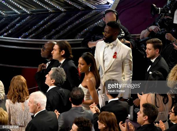 Writer/director Barry Jenkins producer Jeremy Kleiner actress Naomie Harris writer Tarell Alvin McCraney look on from the audience as 'Moonlight' is...