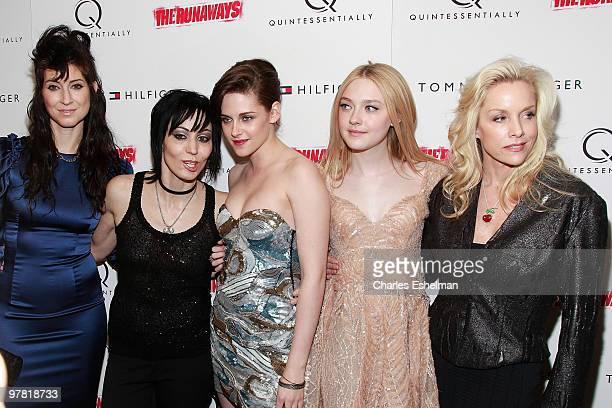 Writer/director Floria Sigismondi musician Joan Jett actress Kristen Stewart actress Dakota Fanning and musician Cherie Currie attend 'The Runaways'...