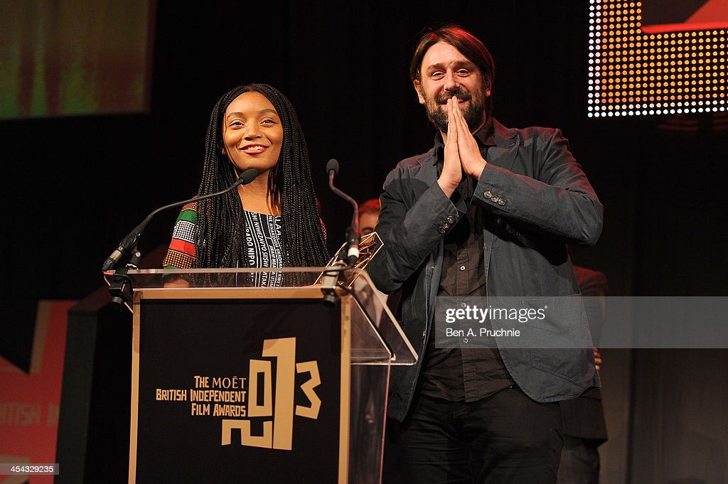 Writer/Director Gabriel Gauchet (R) and writer Rungano Nyoni receive the Best British Short award for 'Z1' as they attend the ceremony for the Moet British Independent Film Awards at Old Billingsgate Market on December 8, 2013 in London, England.