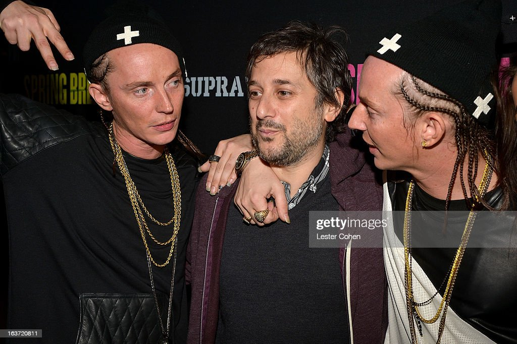 Writer/Director <a gi-track='captionPersonalityLinkClicked' href=/galleries/search?phrase=Harmony+Korine&family=editorial&specificpeople=2613576 ng-click='$event.stopPropagation()'>Harmony Korine</a> (C) and The ATL Twins attend the 'Spring Breakers' Los Angeles Premiere at ArcLight Hollywood on March 14, 2013 in Hollywood, California.