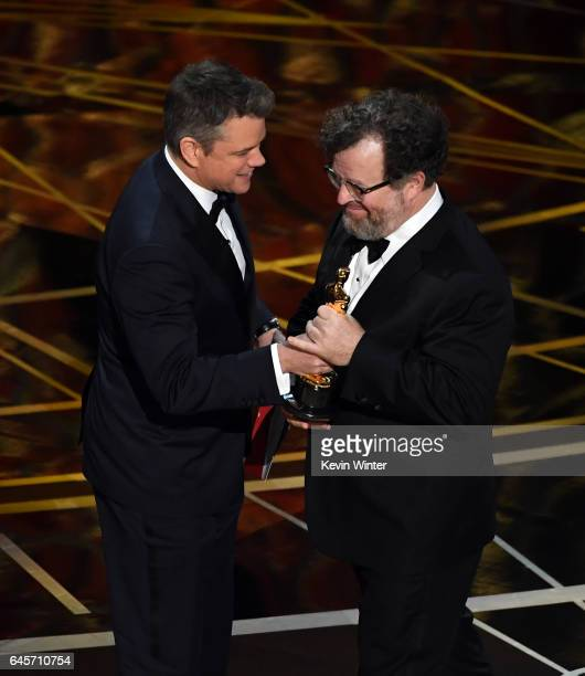 Writer/director Kenneth Lonergan accepts Best Original Screenplay for 'Manchester by the Sea' from actor/producer Matt Damon onstage during the 89th...
