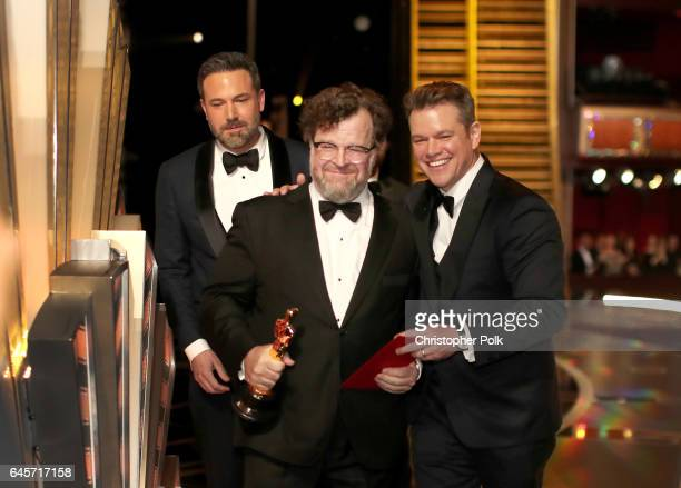 Writer/director Kenneth Lonergan accepts the Best Original Screenplay award for 'Manchester by the Sea' from actors Ben Affleck and Matt Damon...