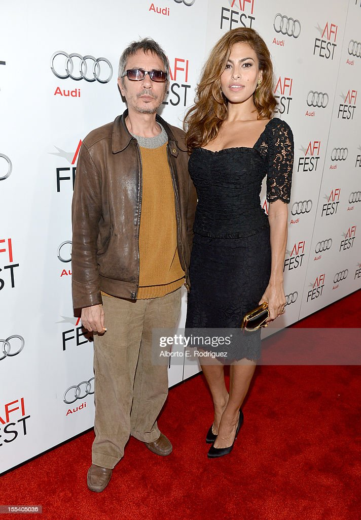 Writer/director Leos Carax (L) and actress Eva Mendes arrive at the 'Holy Motors' special screening during the 2012 AFI Fest at Grauman's Chinese Theatre on November 3, 2012 in Hollywood, California.