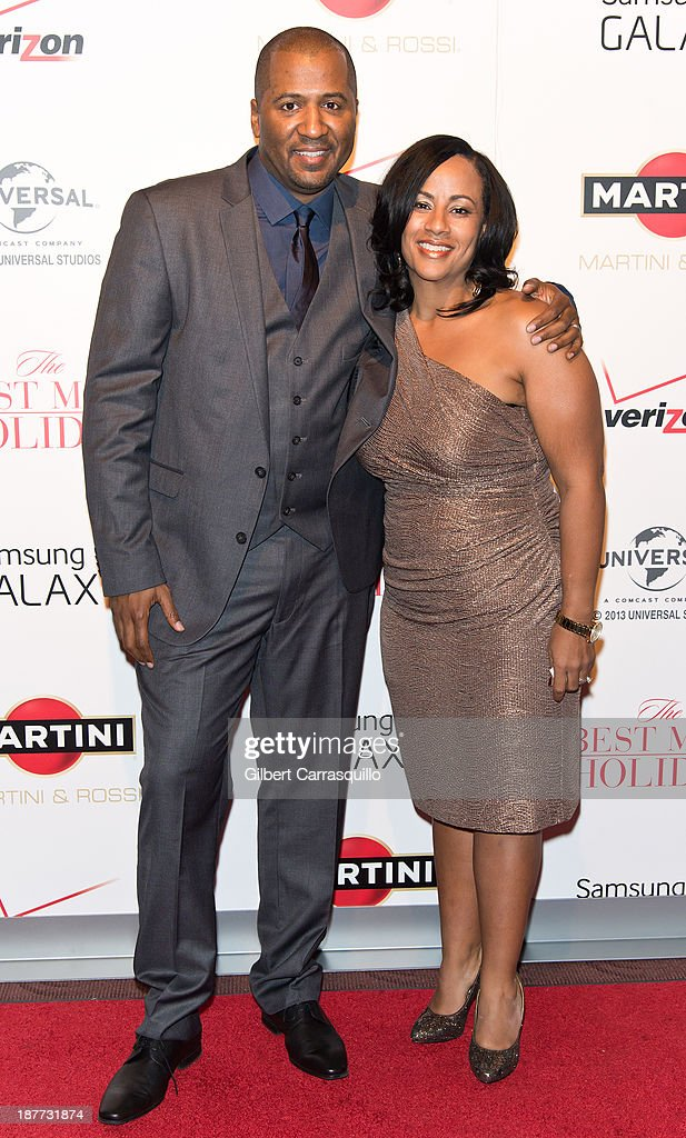 Writer/director <a gi-track='captionPersonalityLinkClicked' href=/galleries/search?phrase=Malcolm+D.+Lee&family=editorial&specificpeople=2158861 ng-click='$event.stopPropagation()'>Malcolm D. Lee</a> and wife Camille Lee Lee attend 'The Best Man Holiday' screening at Chelsea Bow Tie Cinemas on November 11, 2013 in New York City.