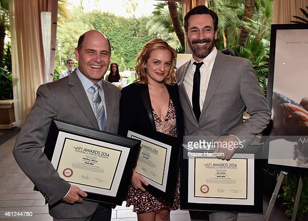 Writerdirector Matthew Weiner and actors Elisabeth Moss and Jon Hamm pose with awards during the 15th Annual AFI Awards at Four Seasons Hotel Los...