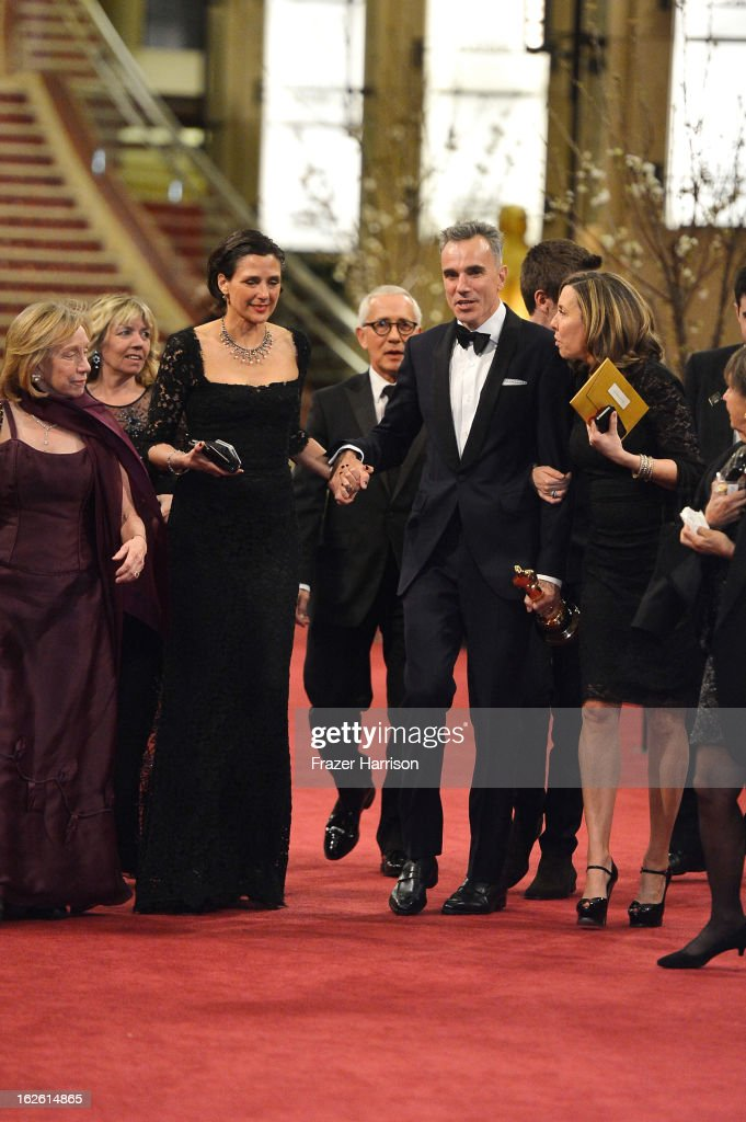 Writer/director Rebecca Miller (3rd L) and actor Daniel Day-Lewis (2nd R), winner of the Best Actor award for 'Lincoln', depart the Oscars at Hollywood & Highland Center on February 24, 2013 in Hollywood, California.