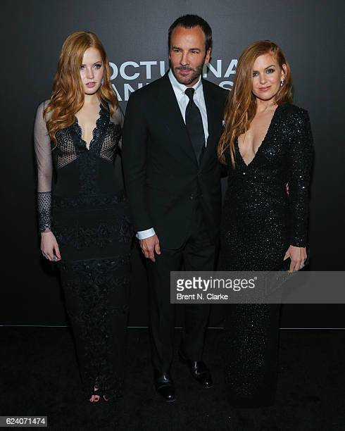 Writer/director Tom Ford poses with actresses Ellie Bamber and Isla Fisher during the 'Nocturnal Animals' New York premiere held at The Paris Theatre...