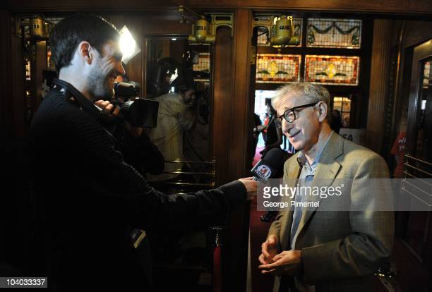 Writer/director Woody Allen is interviewed as he attends the 'You Will Meet A Tall Dark Stranger' Premiere held at the Visa Screening Room At The...